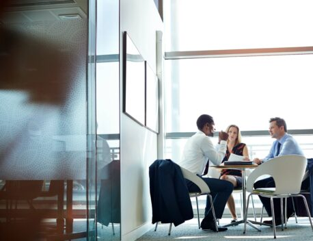 Three people having a meeting in an office